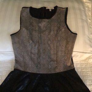 Monteau faux leather drop waist top